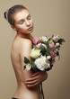 Young Dreamy Woman with Bouquet of Flowers