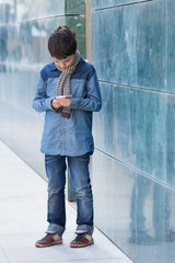 child looks at his phone