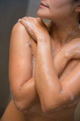 girl cleaning her body with shower cream