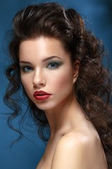 Portrait of Beautiful Young Woman with red lips and bright makeu