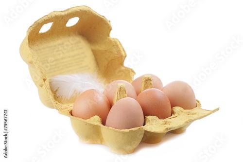 Leinwanddruck Bild Braune Hühnereier im Eierkarton