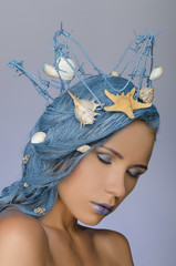 attractive woman with blue hair, crown and shells
