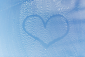close up of heart shape on soapy window glass