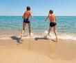 Kids run to the sea