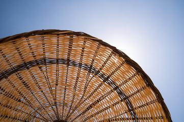 Straw umbrella on a beach.