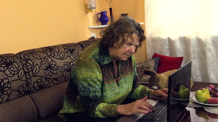 grandma slowly push button on laptop, learn use new technologies