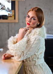 young beautiful woman in knitted coat