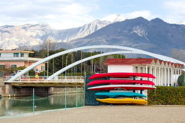 Winter storage of canoes colorful backdrop of snow-covered Alps