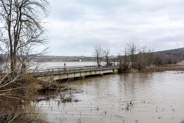 Flood - a natural phenomenon. Spilled lake submerged fields.