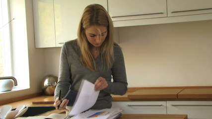 WS OF A YOUNG WOMAN SORTING OUT HER FINANCES