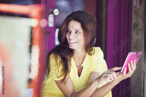 Happy woman with cel phone - 79571721
