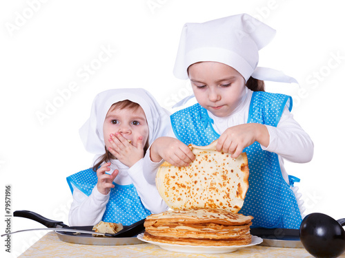 Little children with pancakes. Two cute girls playing as chefs - 79571916