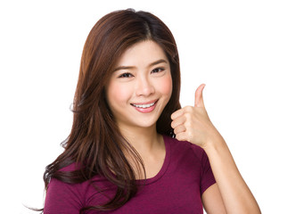 Portrait of a beautiful young asian woman showing thumbs up