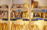 Freshly baked breads in French bakery - 79572941