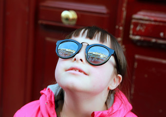 Closeup portrait of girl in sunglasses, outdoors