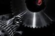 titanium parts, cogwheels and gears against space concept