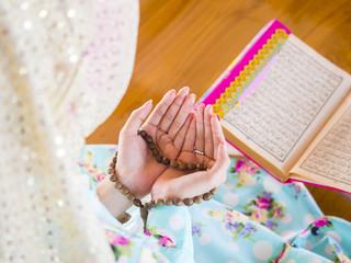 young muslim woman praying for Allah
