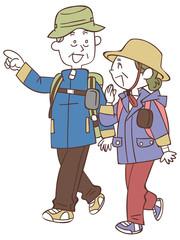 ハイキングする老夫婦