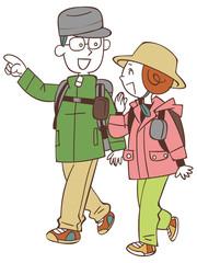 ハイキングする夫婦