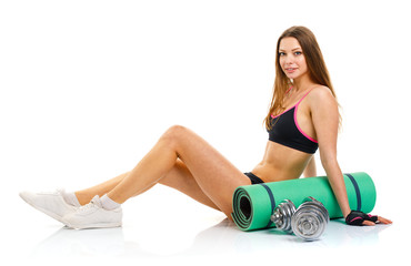 Beautiful sport woman with dumbbells, mat for fitness, a bottle