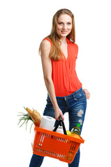 Young caucasian woman with assorted grocery products in shopping