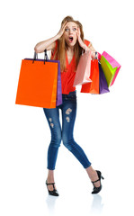 Young caucasian woman holding shopping bags on white background
