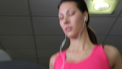 Female running on treadmills, cardio workout exercise in gym