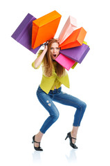 Happy caucasian woman holding shopping bags on white background