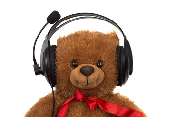 toy teddy bear wearing head set isolated over white