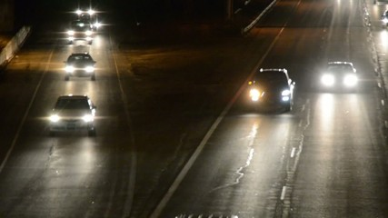 Traffic merging onto a freeway at night