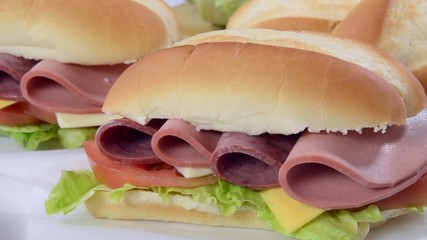 Panning across a bogie sandwich with cold cuts and cheese