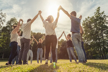 """Постер, картина, фотообои """"Group of ten friends at the park holding hands"""""""