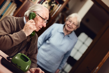Senior couple at the telephone