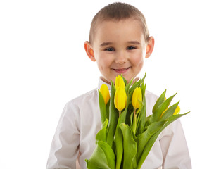 smiling little boy giving tulips