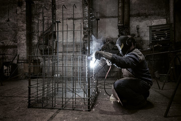 Welder with protective mask welding reinforcement bars