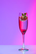 Champagne glass with strawberry, studio shot with light effects - 79581137