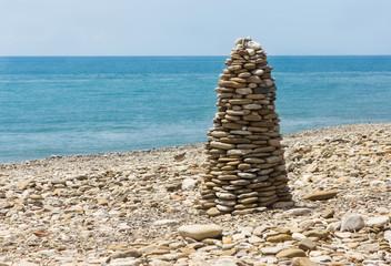 Pyramid pebble on sea beach