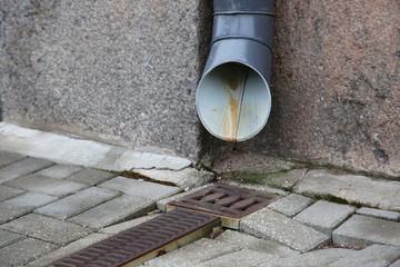 Water drain near wall on the street