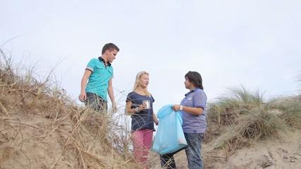 Teenagers Volunteering Beach Cleanup
