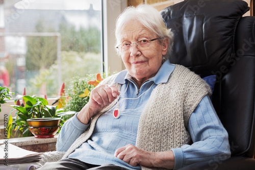 Leinwandbild Motiv Elderly person with emergency button