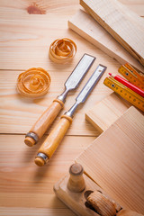 carpentry chisels and other tools on wooden boards construction