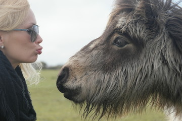 Close up Blond Woman About to Kiss a Hairy Horse