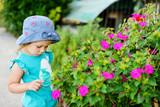 toddler girl near flowers