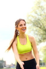 Beautiful woman working out in a park