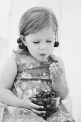 little girl eating merry
