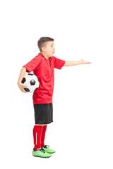Junior football player gesturing displeasure