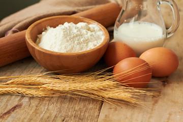 Baking ingredients: eggs, milk, flour, rolling pin