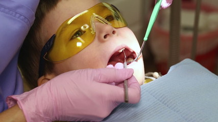 child on reception at the dentist doctor