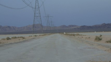 Zoom out of isolated road in desert