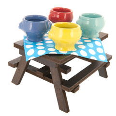 picnic table with soup bowls